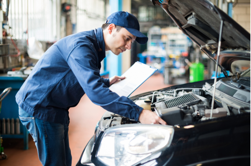 Image to show other costs for driving - mechanic completing MOT to show extra costs